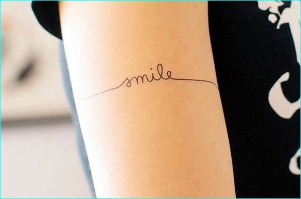 cute-smile-word-tattoos