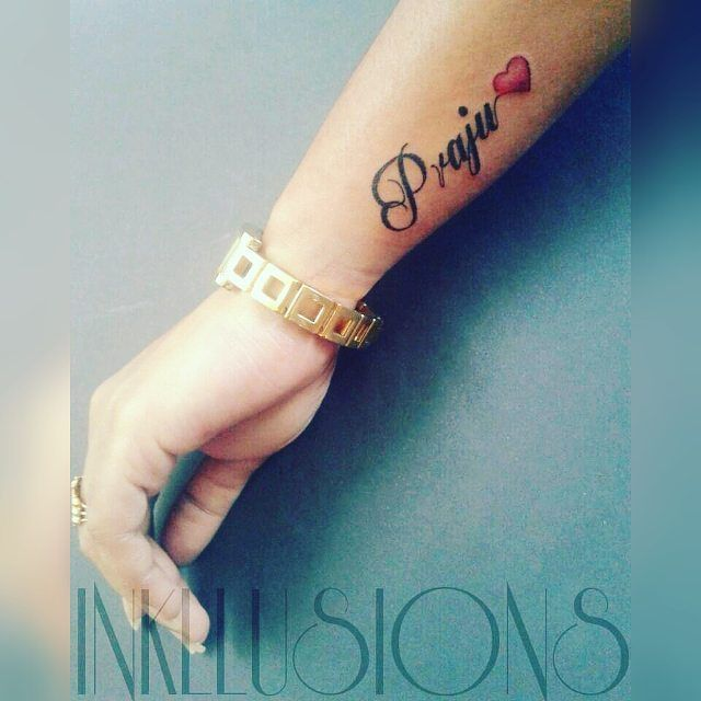 love-symbol-wrist-tattoo